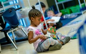 Young girl sitting in class
