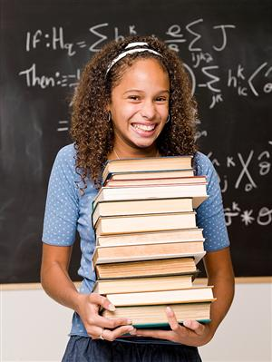 Photo of a student with many books.