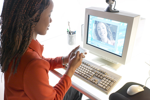 Photo of a woman using a computer.