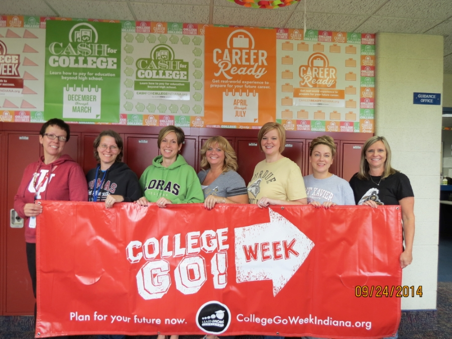 Faculty holding a College Go! Week sign