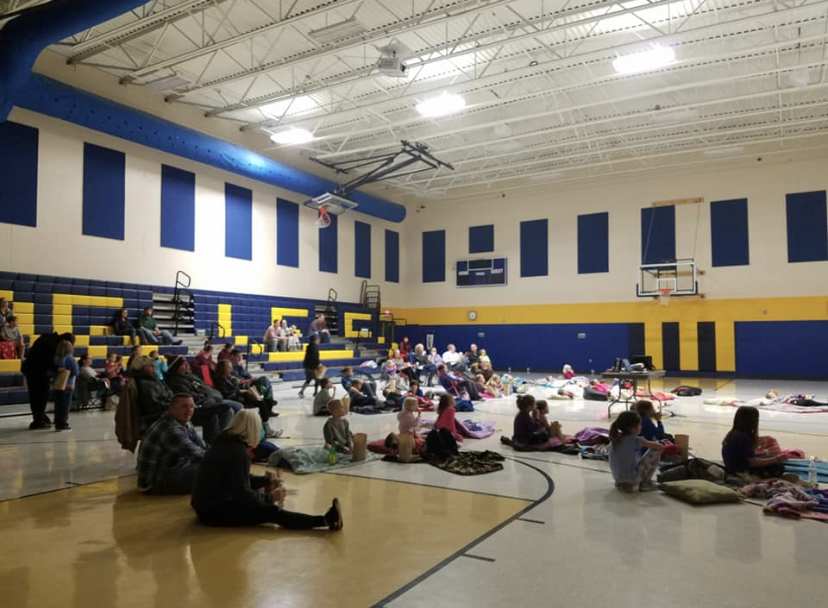 Families gathering for family movie night event.