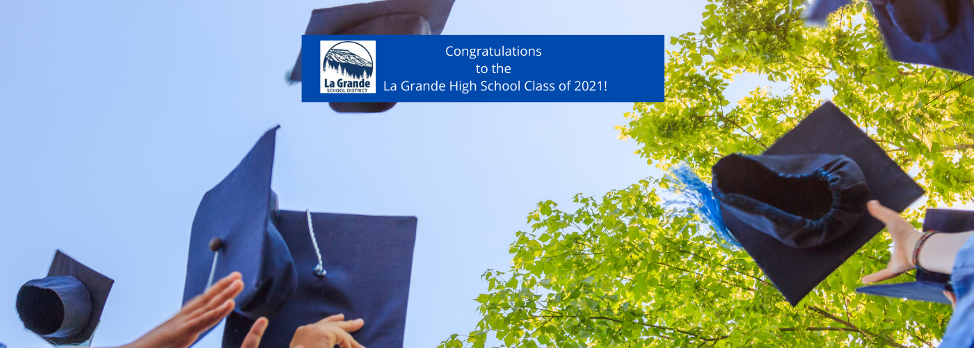 Graduation hats being thrown up into the air with Congratulations to the La Grande High School Class of 2021!