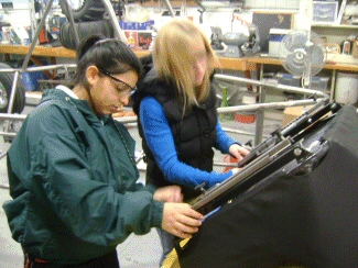 Lupita and Bobbie installing the sliders