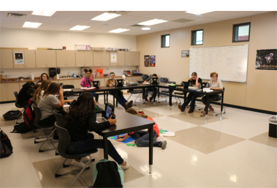 a classroom with kids taking notes