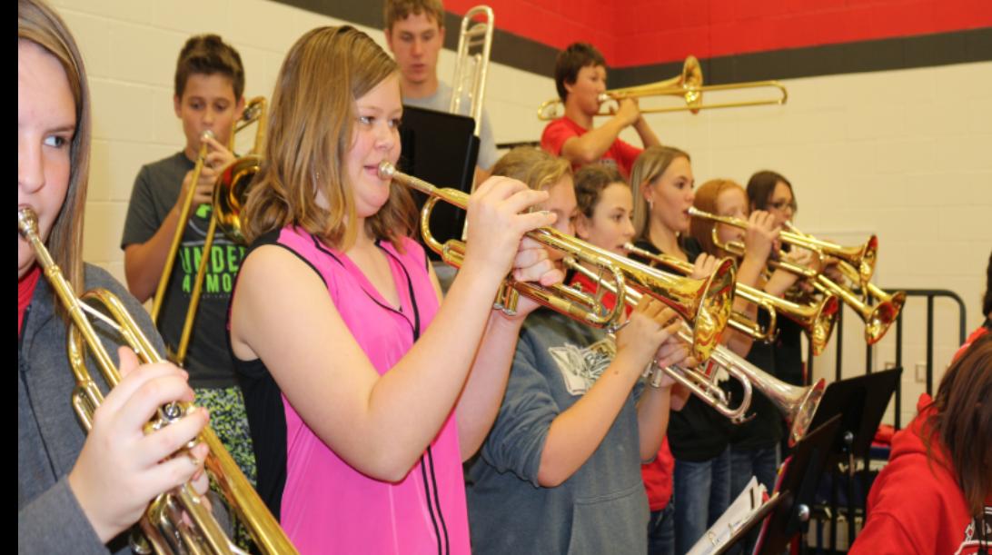 kids playing trumpet