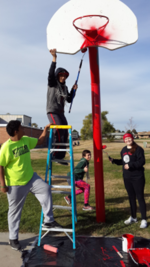 kids fixing a basketball court