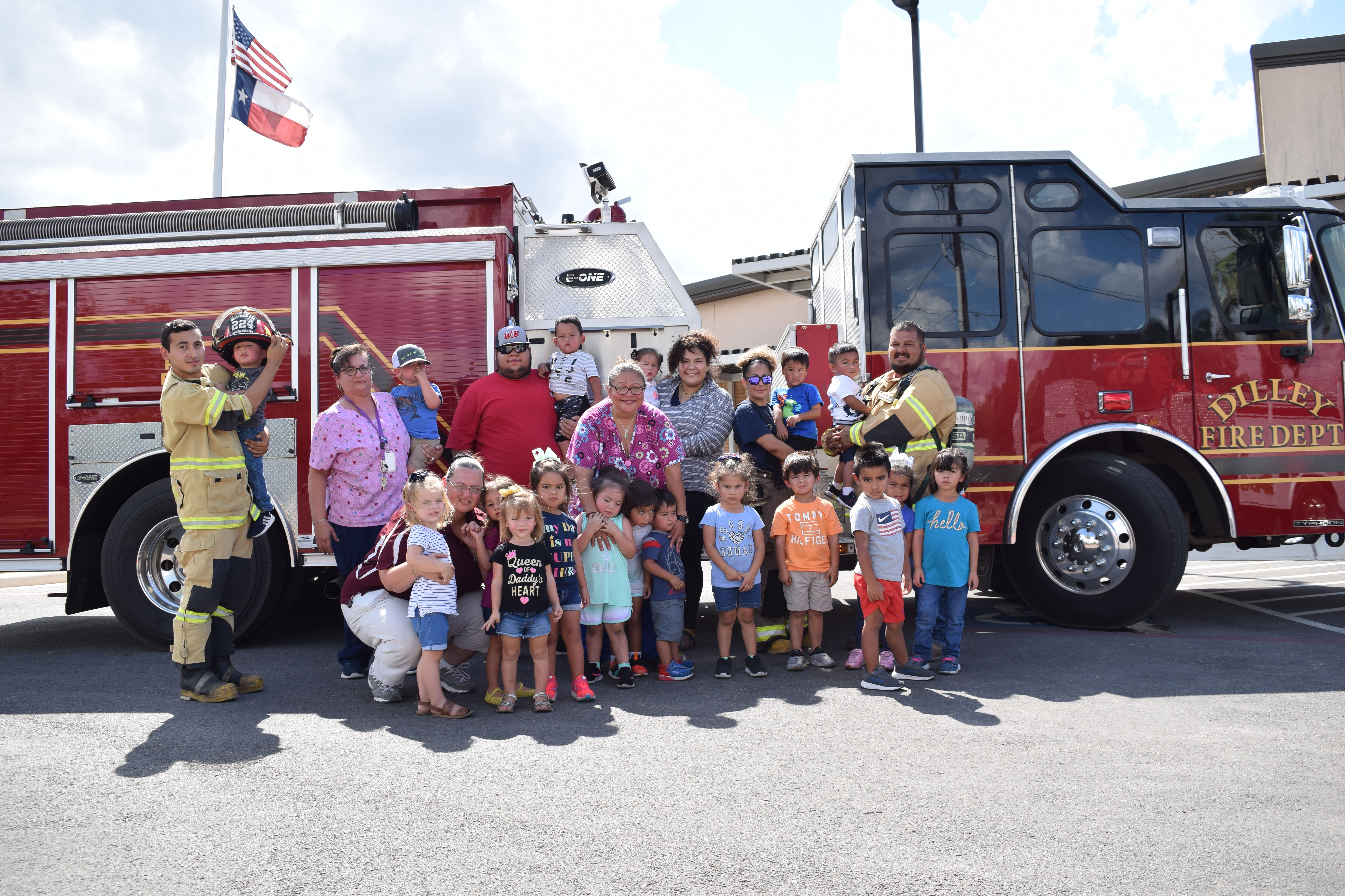 photo of staff and children in front of a fire truck