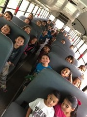 photo of students on a school bus
