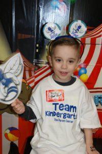Little boy holding paper hornet cutout