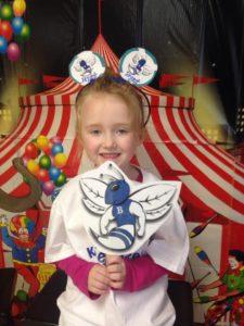Little girl holding paper hornet cutout