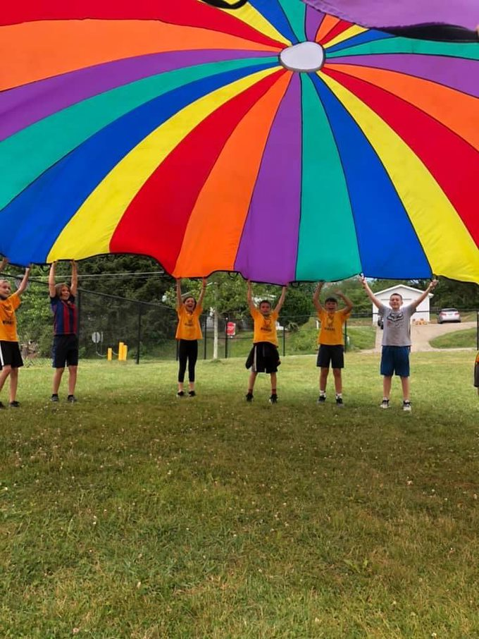 Students enjoying a parachute on Field Day
