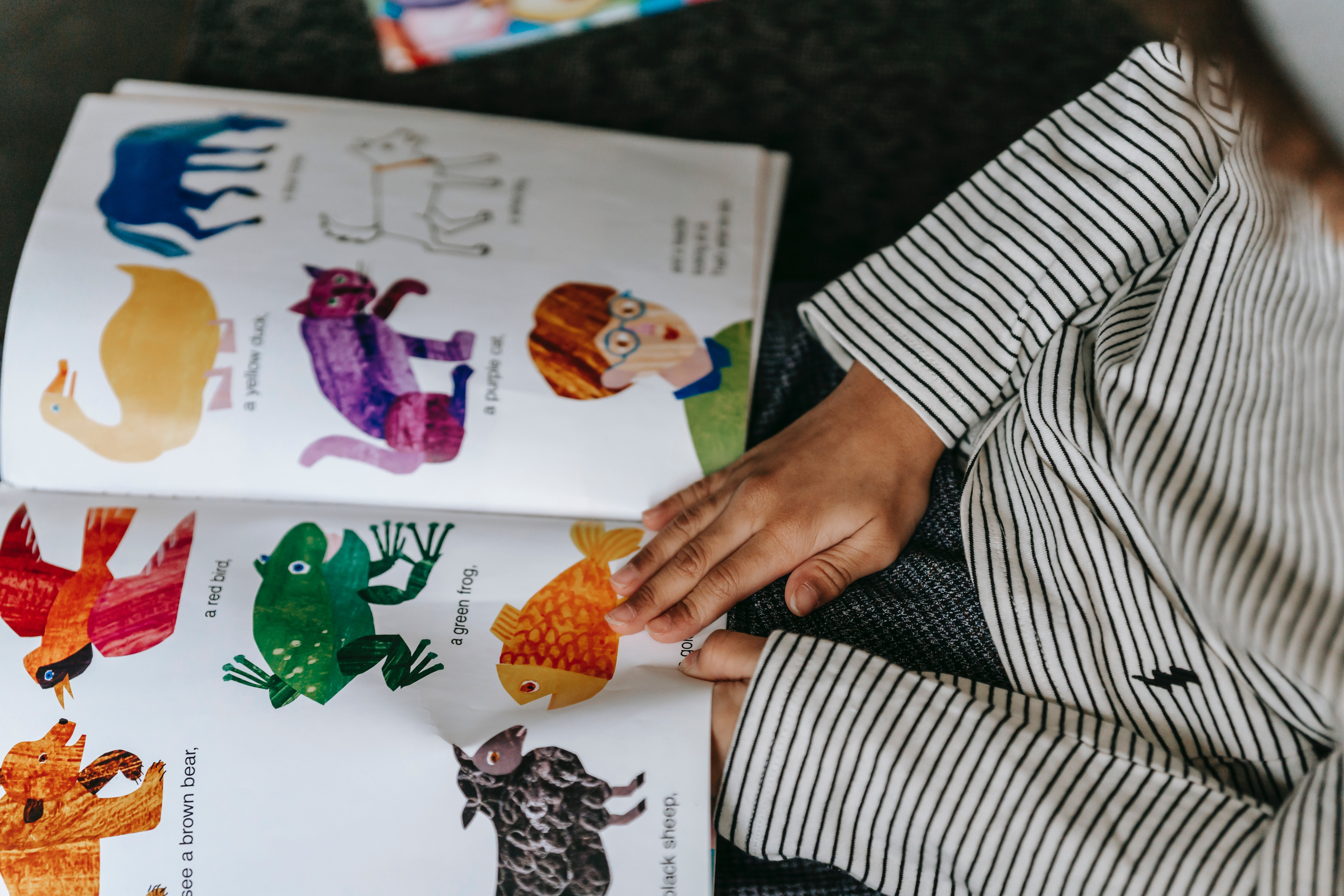 image showing child reading book