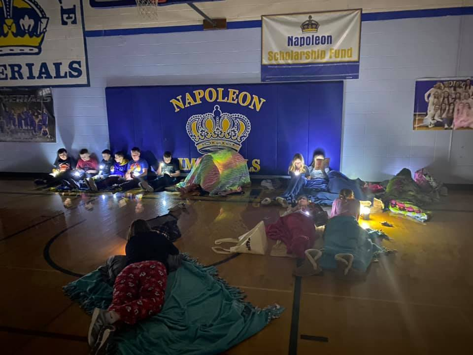 Napoleon students read by flashlight