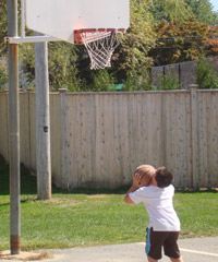 A photo of a student playing basketball.