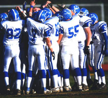 A photo of the football team in the field.