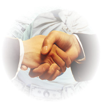 A photo of 2 hand shaking.