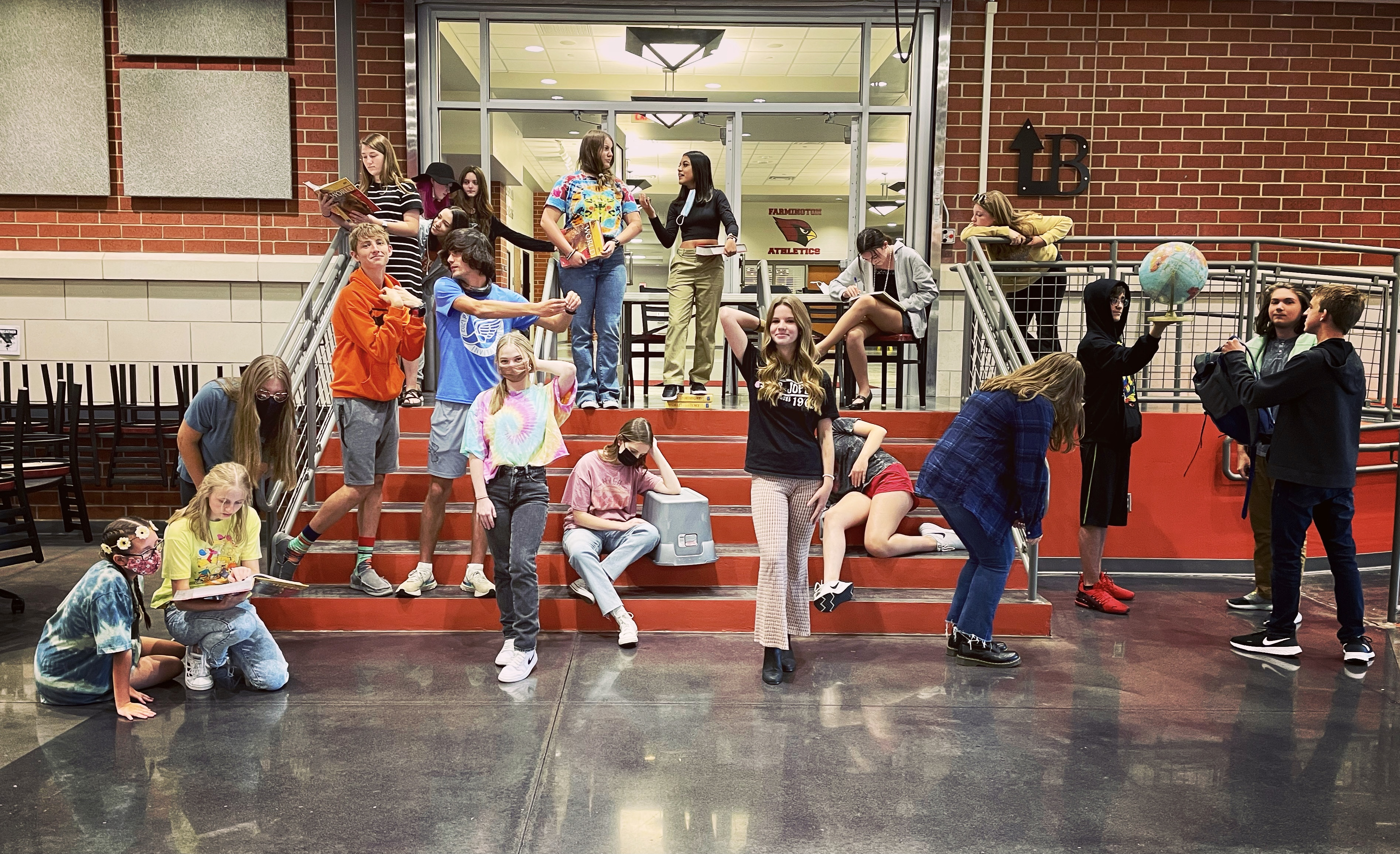 Students posed to recreate Raphael's School of Athens artwork