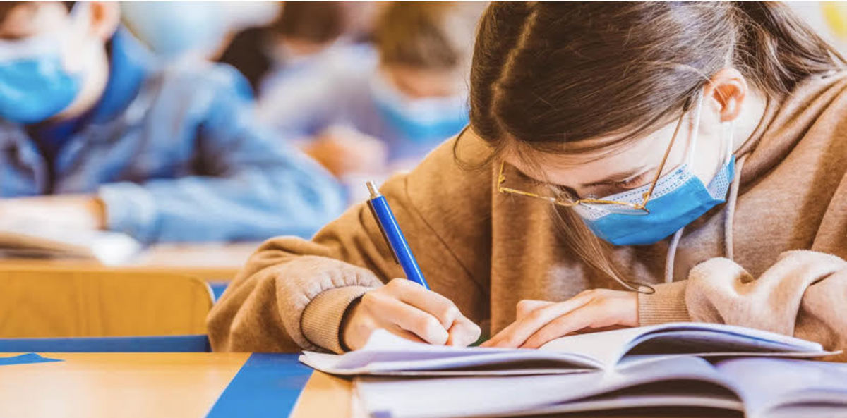 student writing blue pen