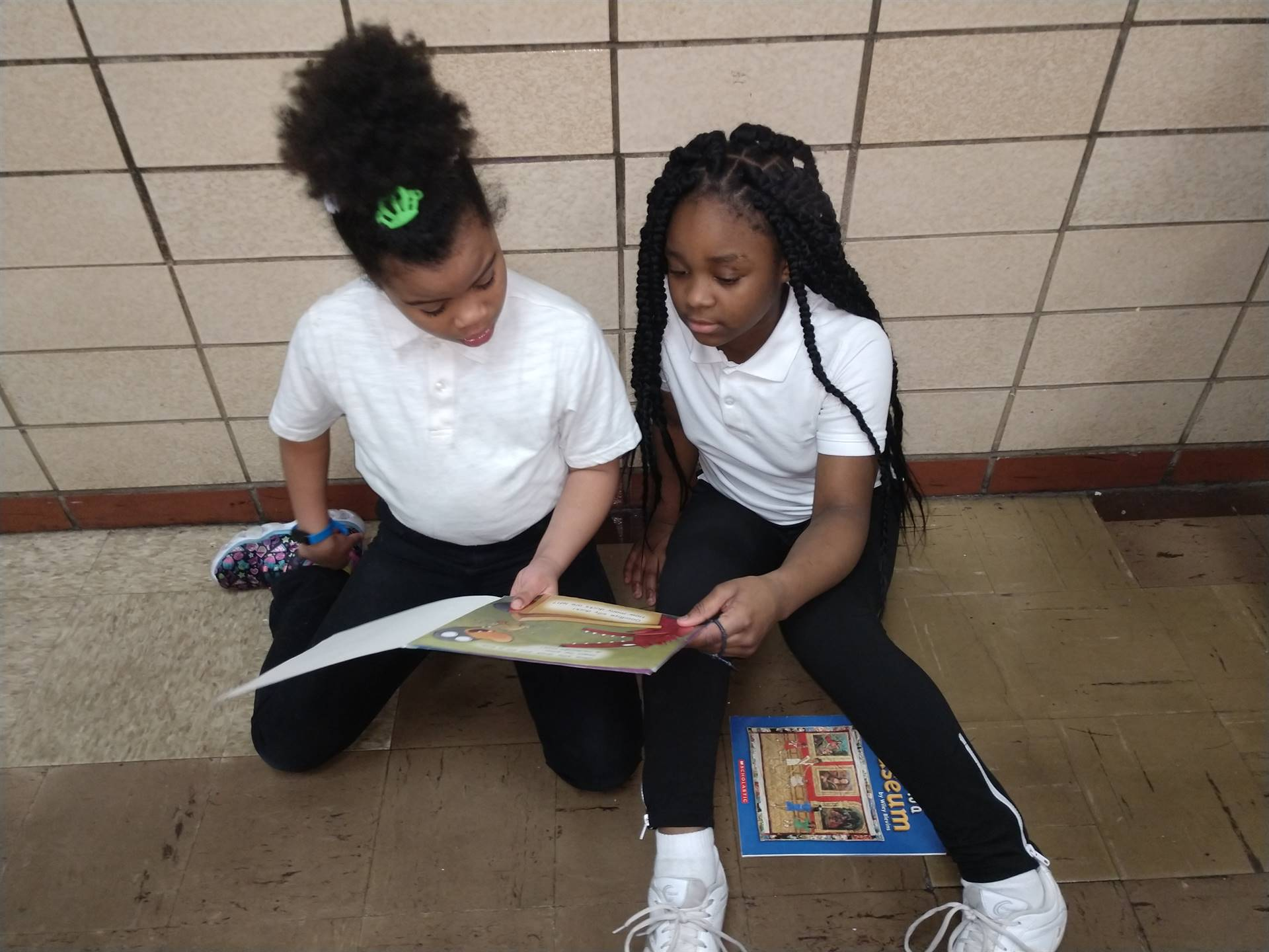 Students Tutoring Students in Reading