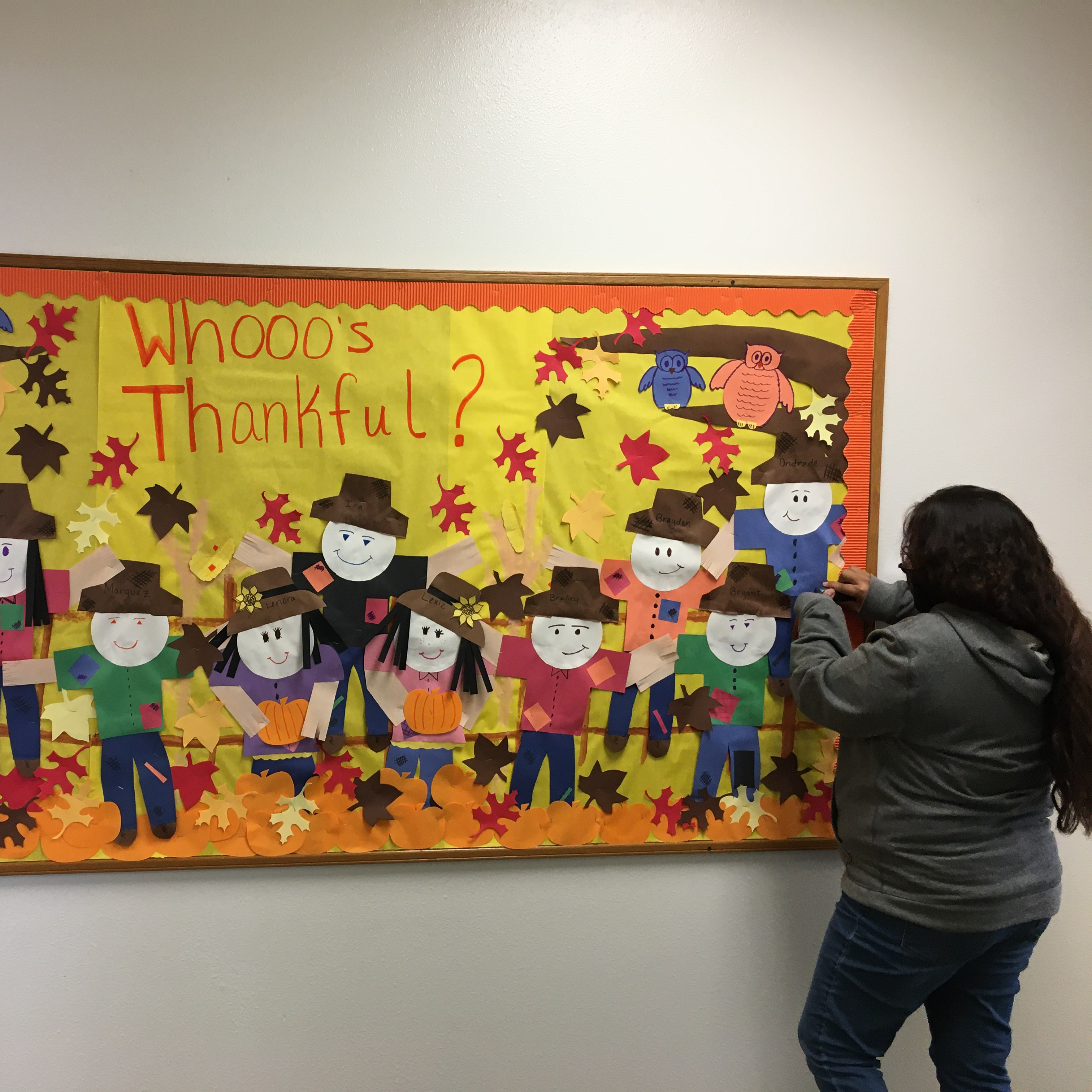 Aides creating bulletin board