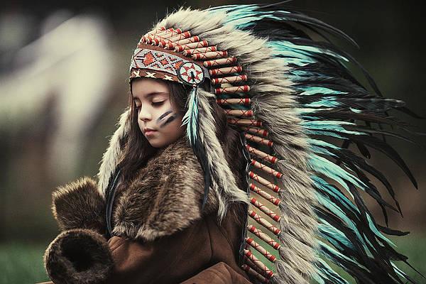 Child wearing a headdress