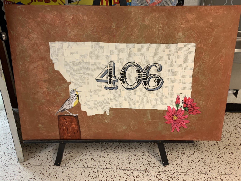"Wolf Point Student Art Montana outline with ""406"" in stylized lettering"