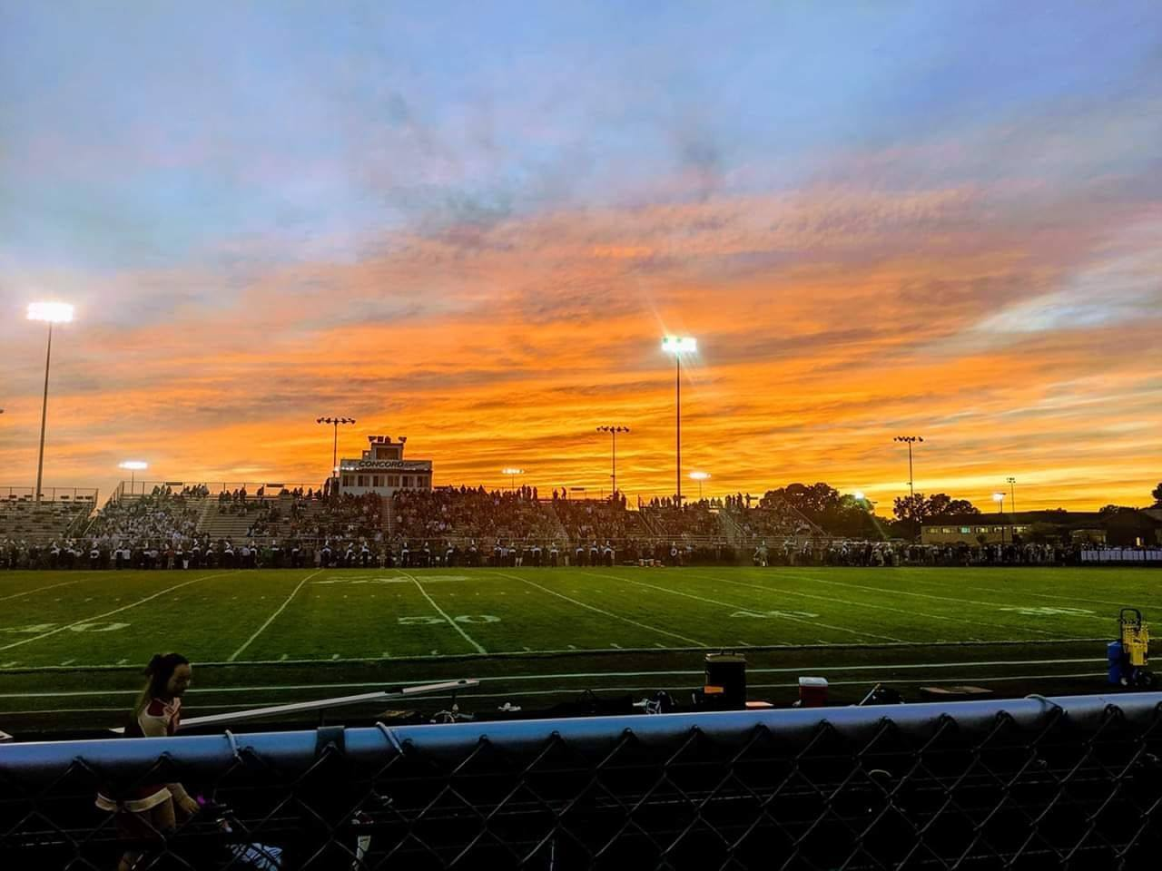 A sunrise over an athletic field