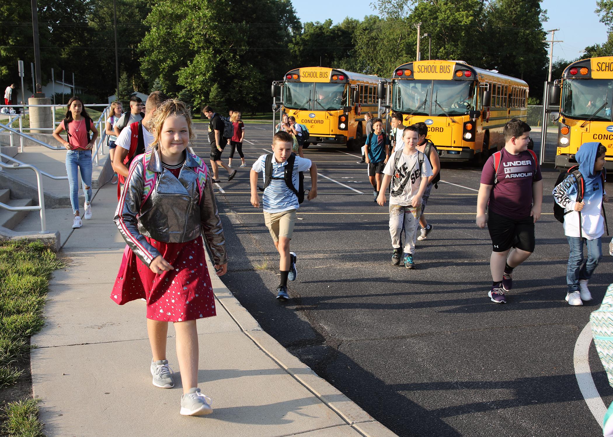 Children leaving their buses