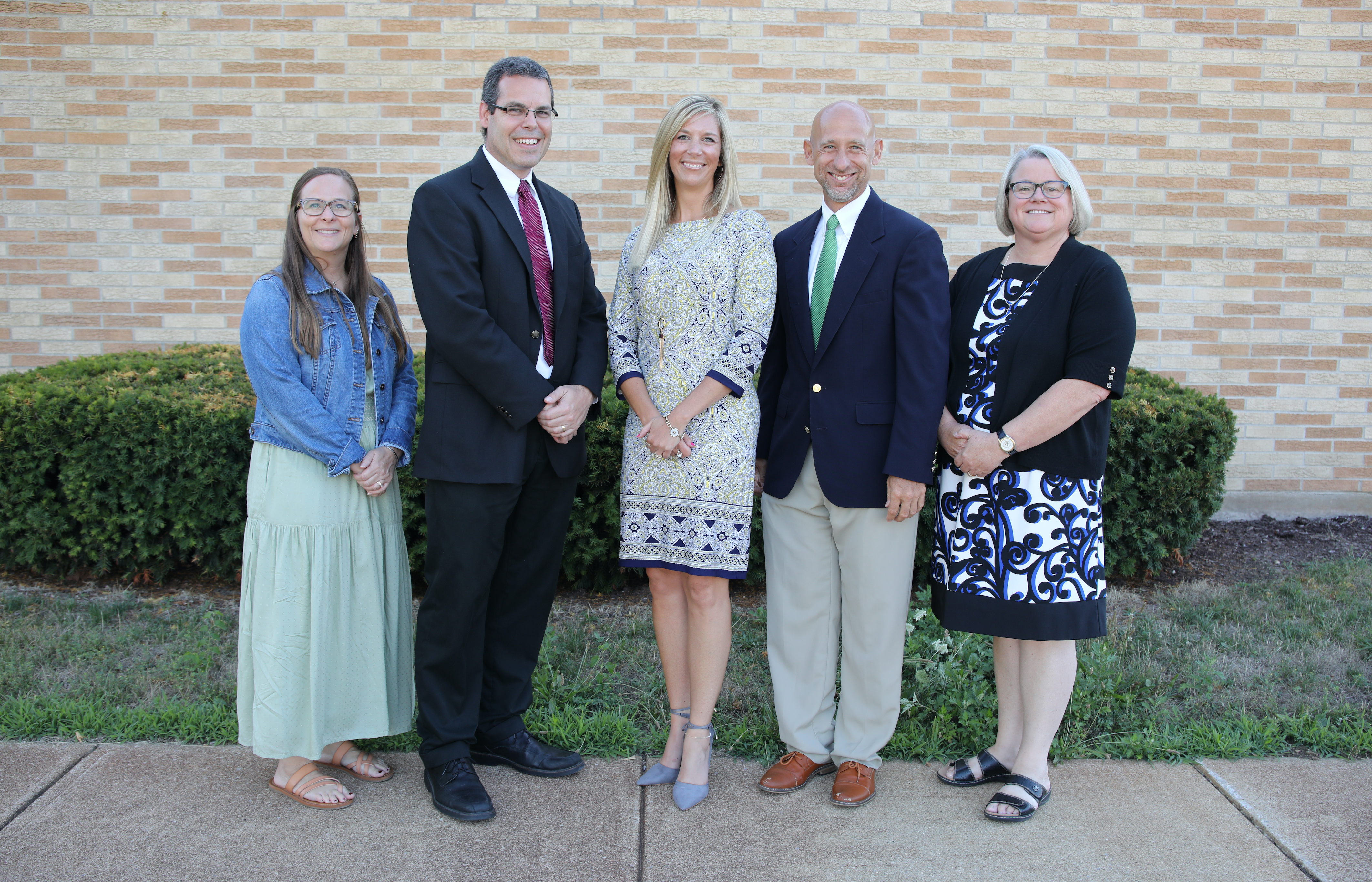 Five school board members pose for a picture