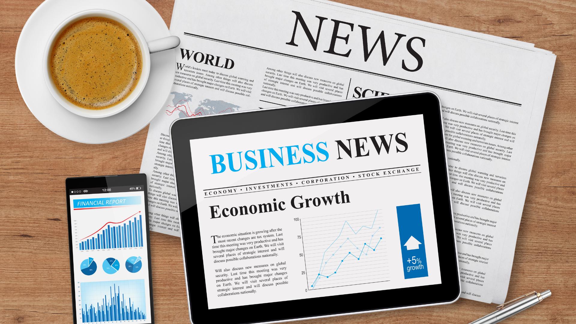 Newspaper with ipad news and coffee