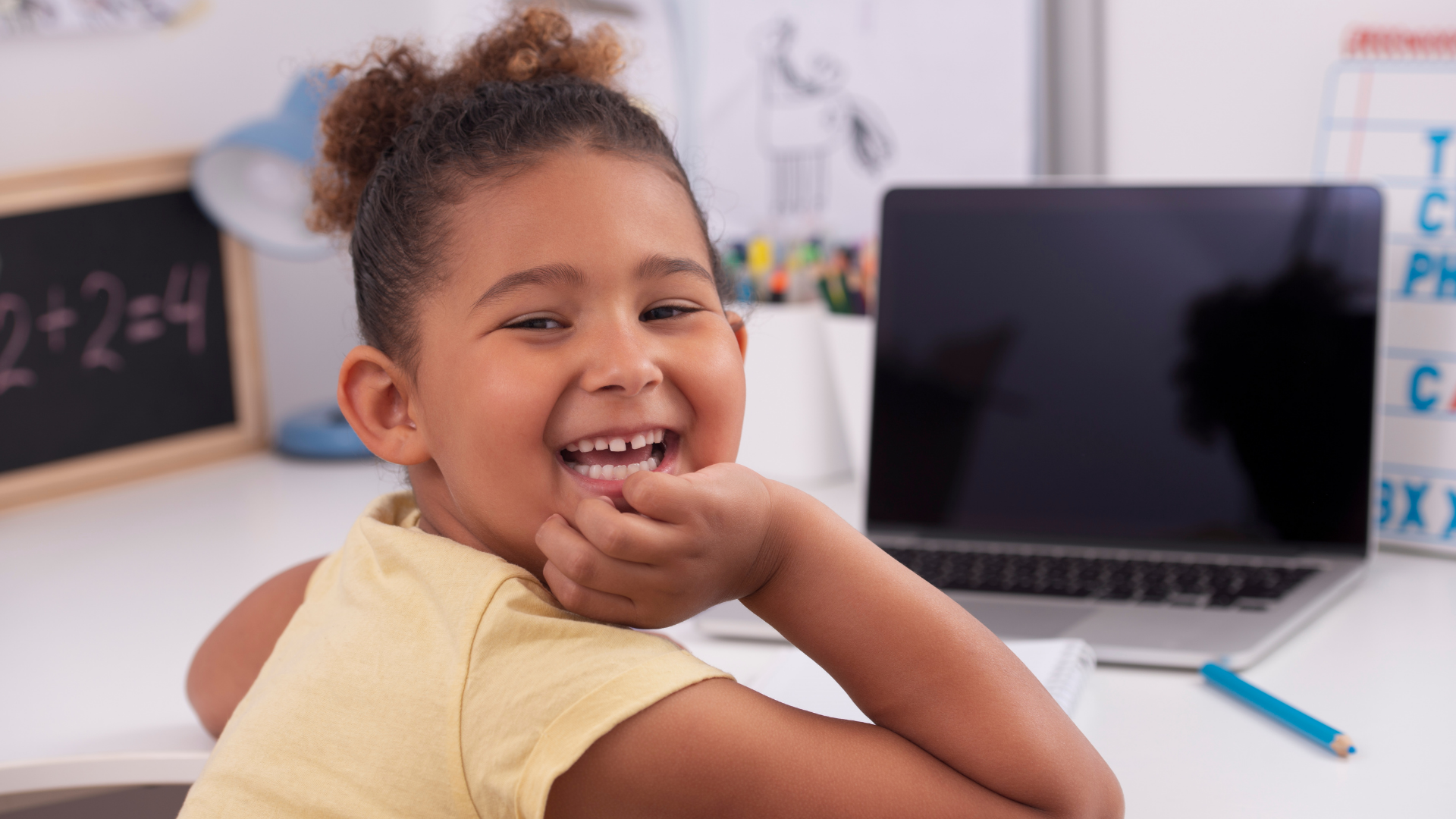 Young black female homeschooler on laptop