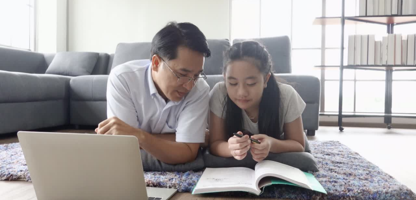 Asian father and daughter learning