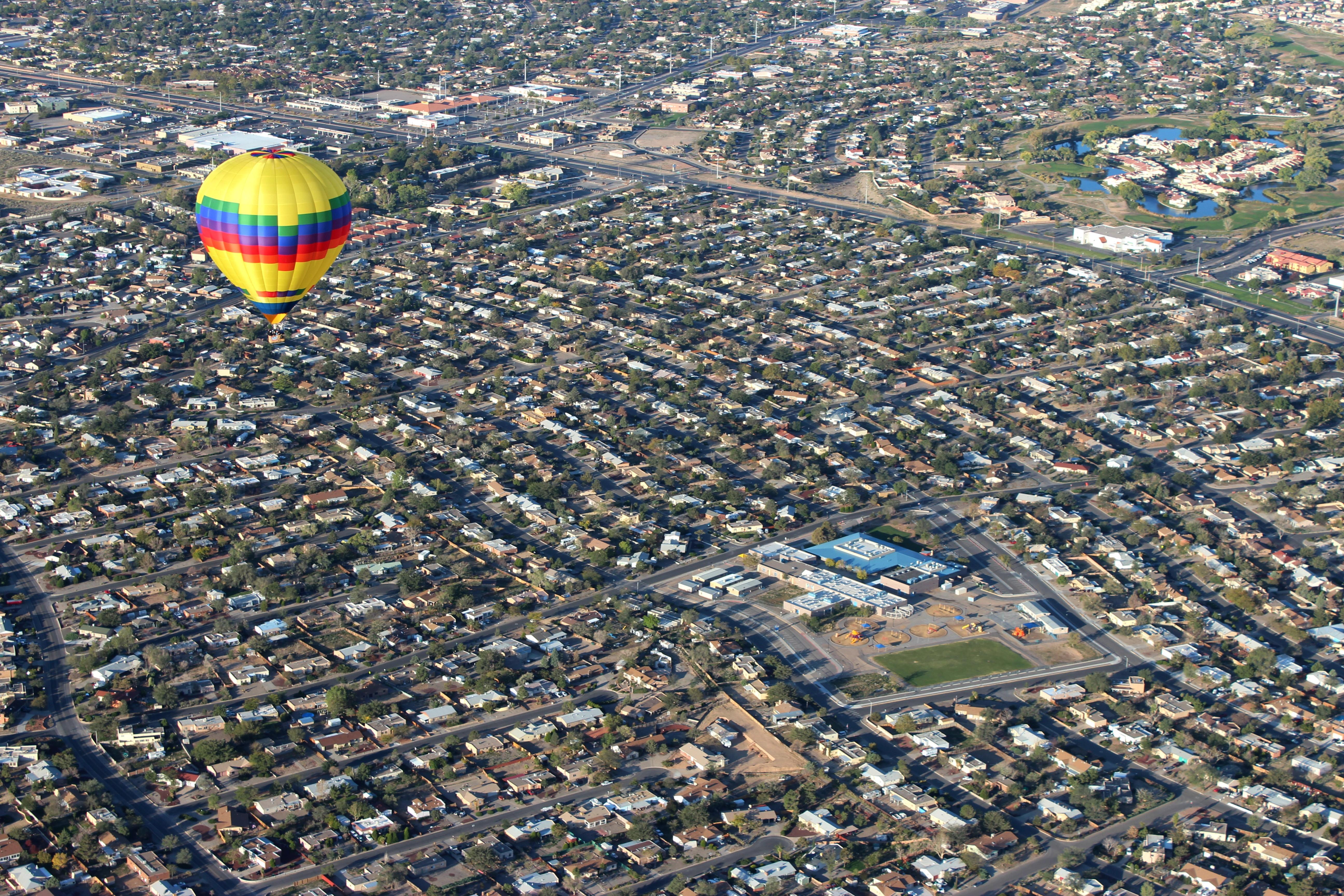 A hot air balloon flies over Rio Rancho Elementary School
