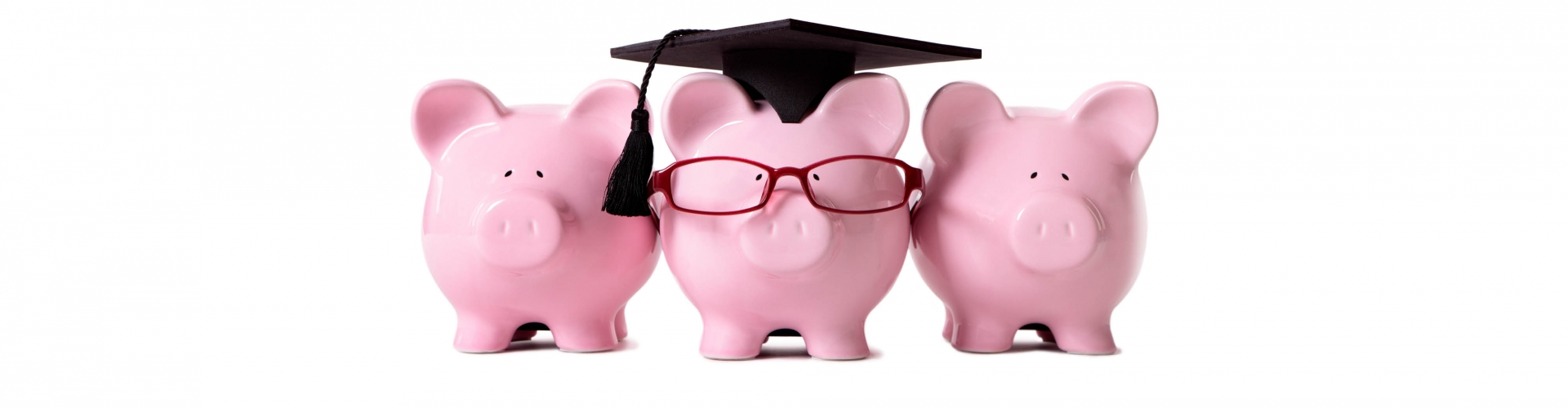 Three piggy banks, middle one has glasses and a graduation cap