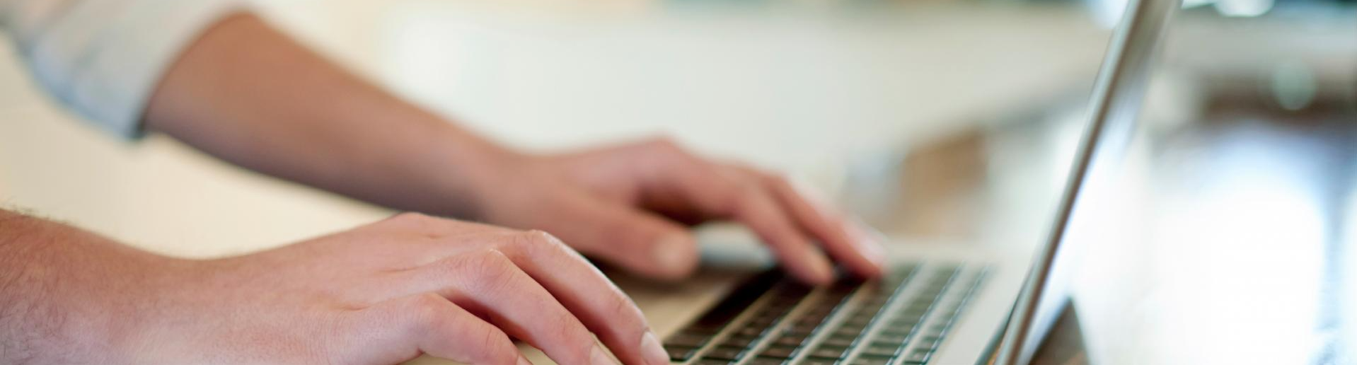 Stock photo of someone typing on a laptop