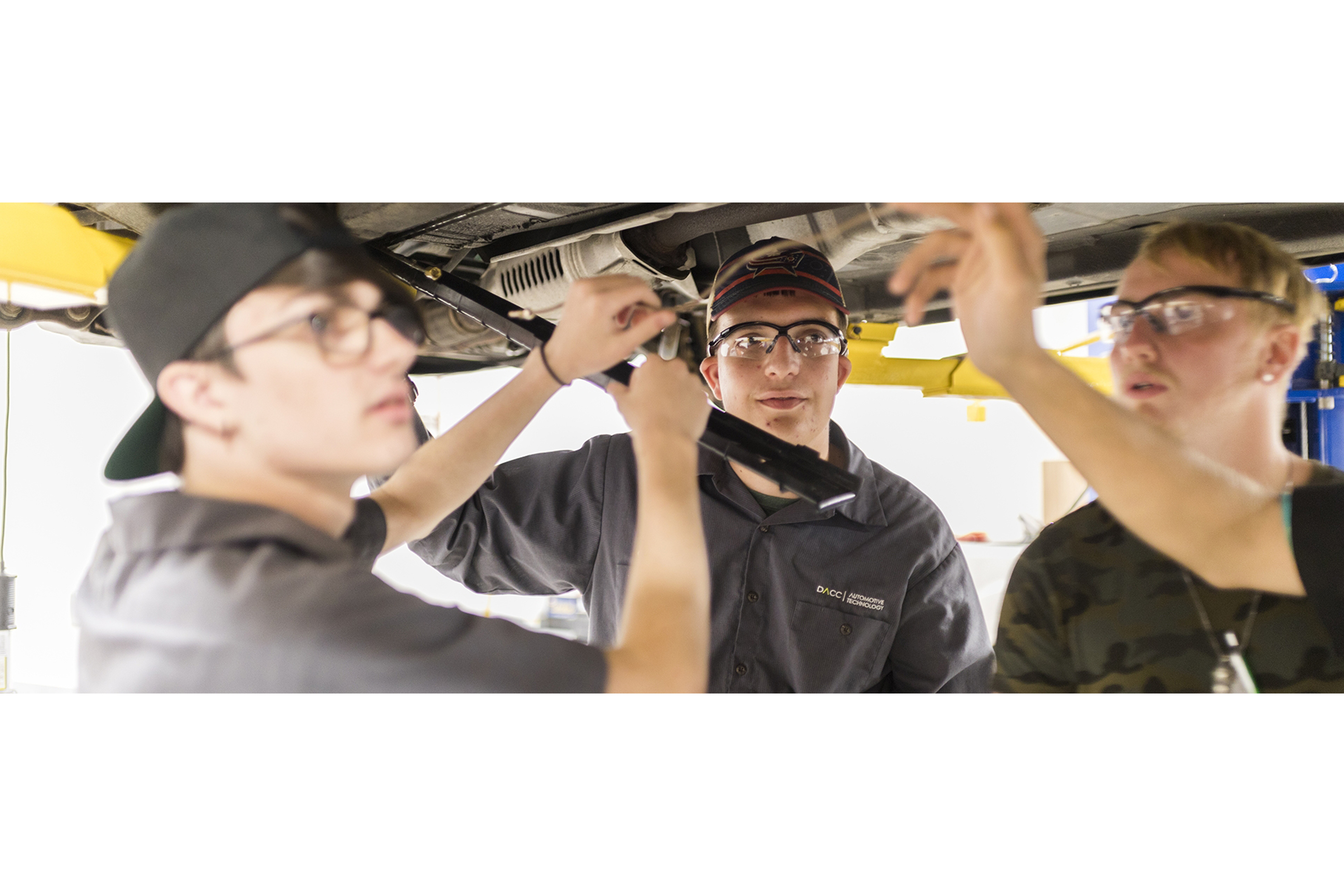 automotive students practice with car