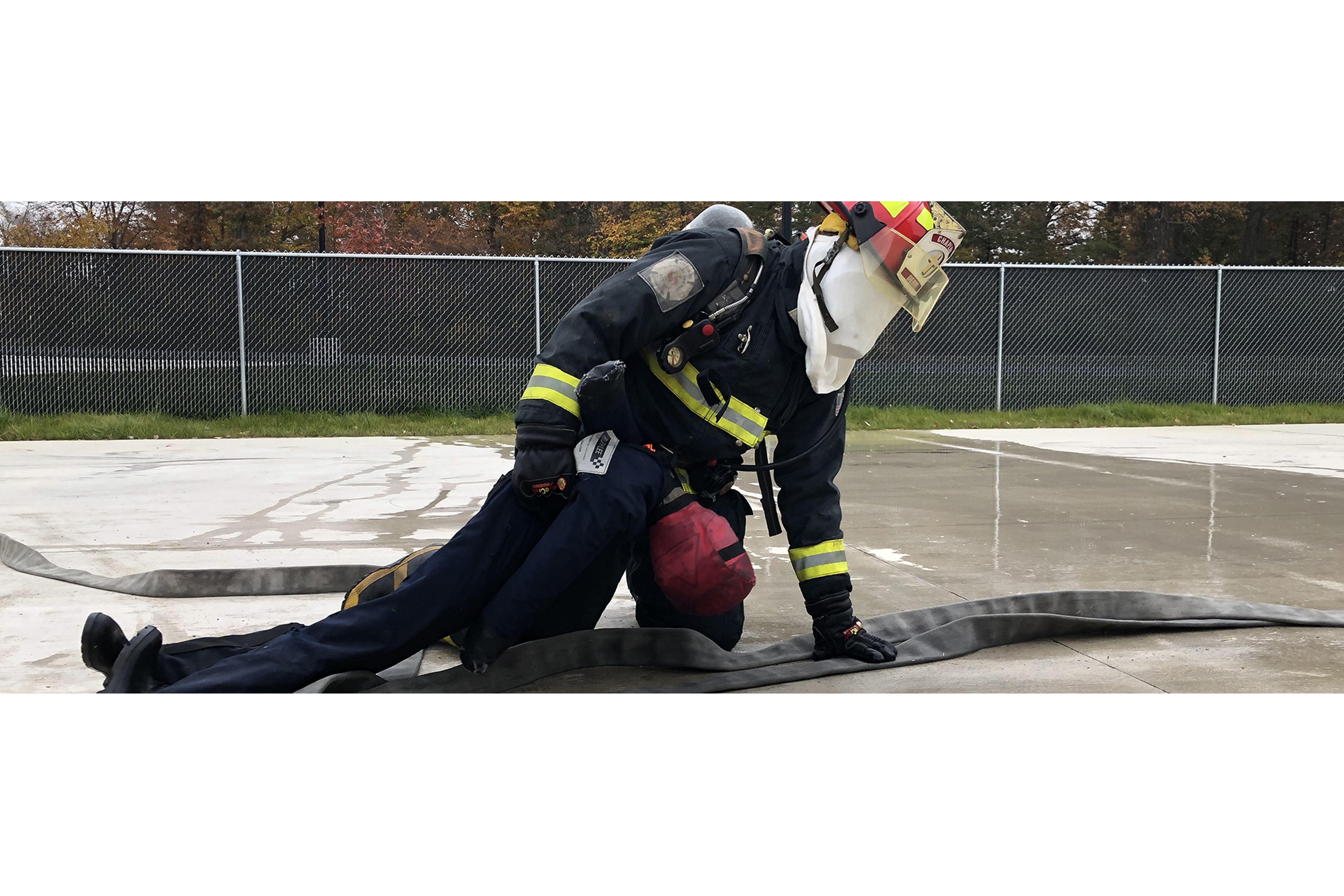 student fire fighter practicing rescues