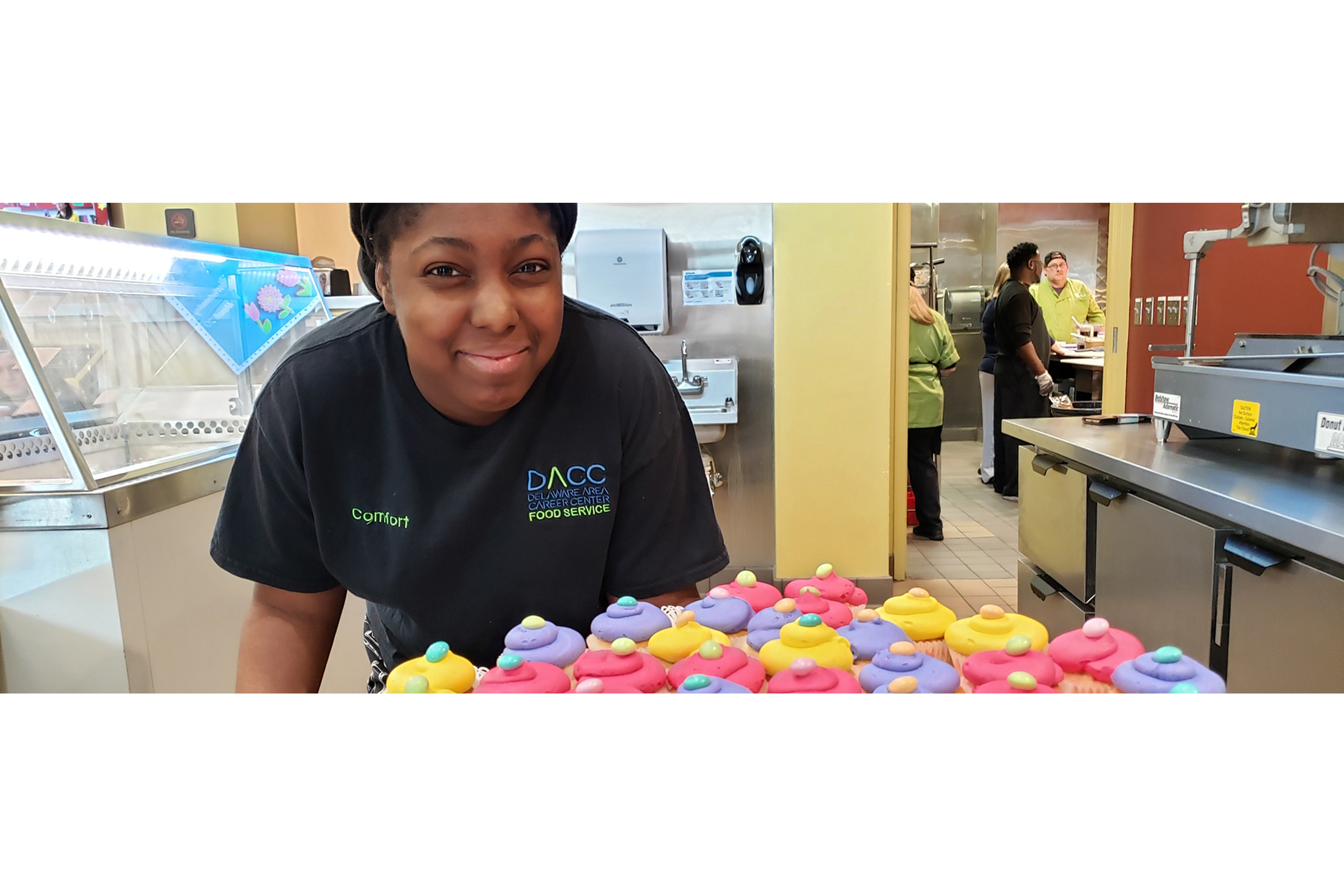 Food Service Student with Cupcakes