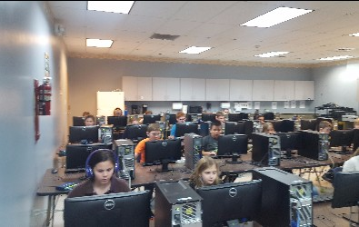 This class is coding (writing) their own computer game!