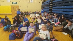 Jr. High students showing off their Hour of Code Certificates