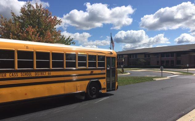 school bus in front of school