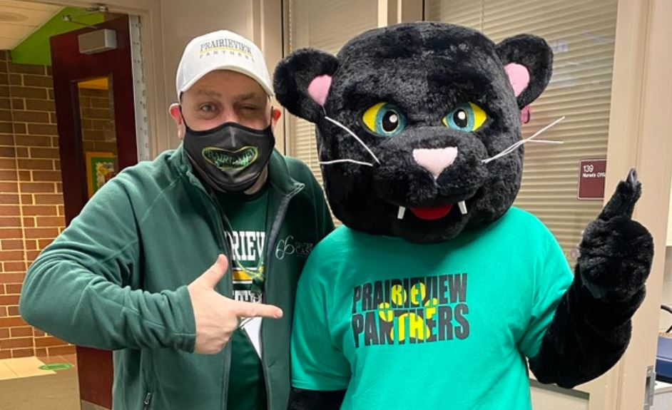 Mr. Pagel pointing at Prairieview panther mascot