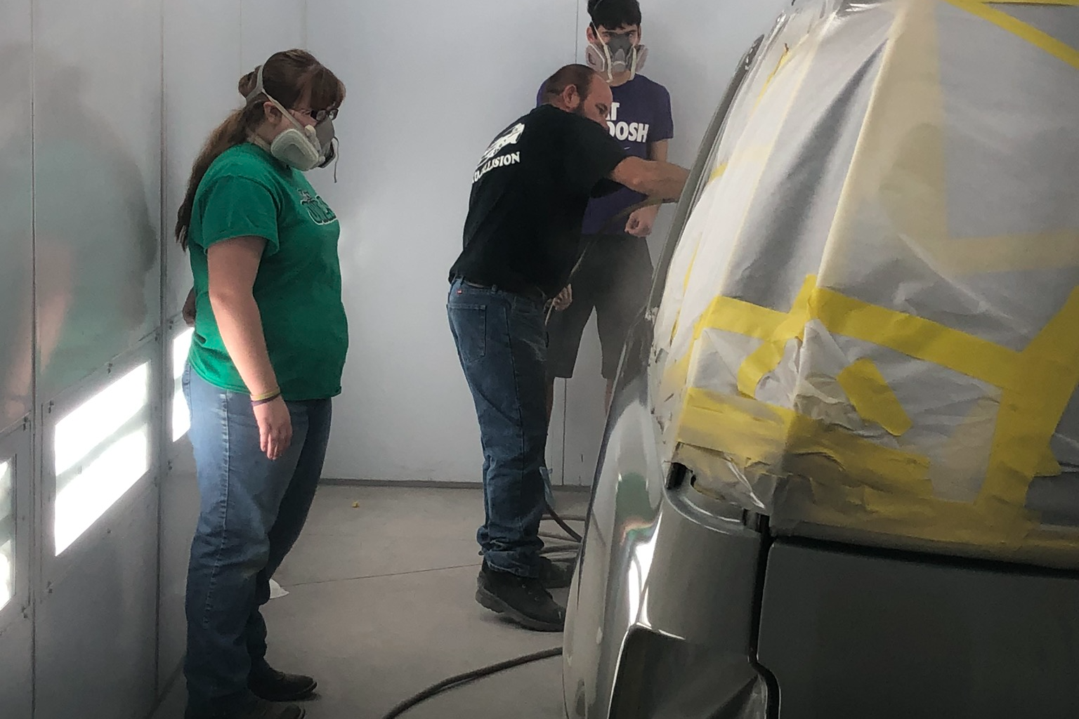 Auto Collision Instructor and students in the paint booth