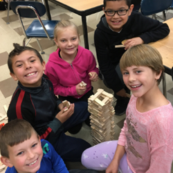 students work together to build