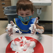 Student playing with foam