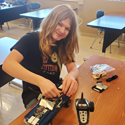 student working on remote control vehicle