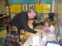 Avon Police Chief Mr. James Carney investigates the scene of the crime with Primary students.