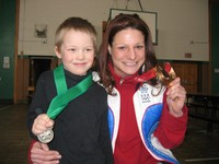 Olympian Kim Insalaco poses with a Student of the Month recipient.