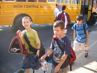 Students head to class after an enjoyable bus ride to school.
