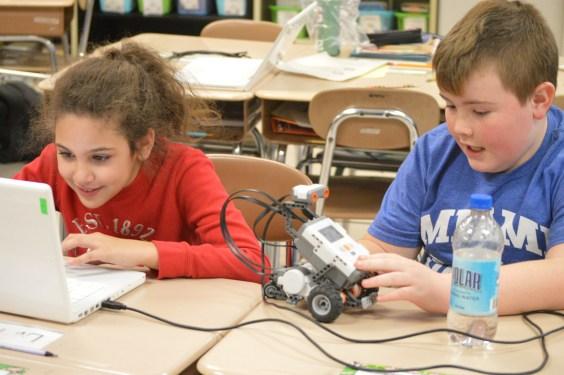Students working in robotics